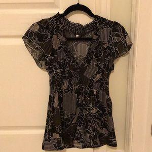 Beautiful black BCBG  silk blouse